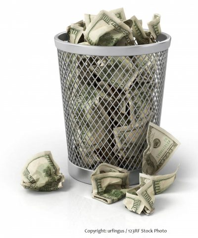 wire basket full of crumpled money $100 dollar bills illustrating the cost of not hiring the right person